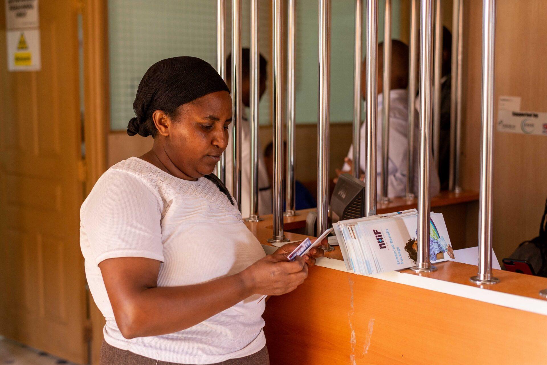 A PROFIT Financial Graduation participant in Samburu, Kenya visits a local NHIF facility.