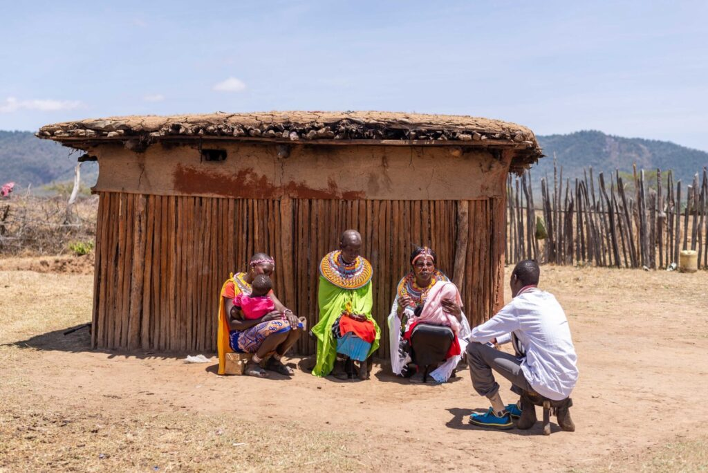A women's entrepreneurial group in Samburu, Kenya meets for bi-weekly coaching as part of their participation in the PROFIT Financial Graduation program. (BRAC/BOMA Project 2019)