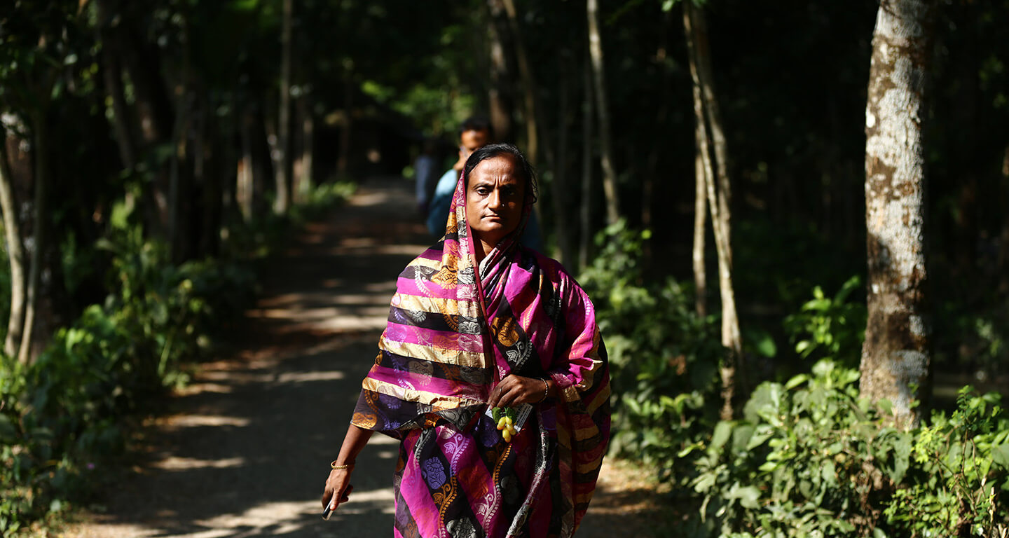 Nurunnahar walking on a forested path