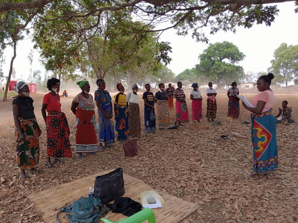 Woman leading an outdoor class in Zambia