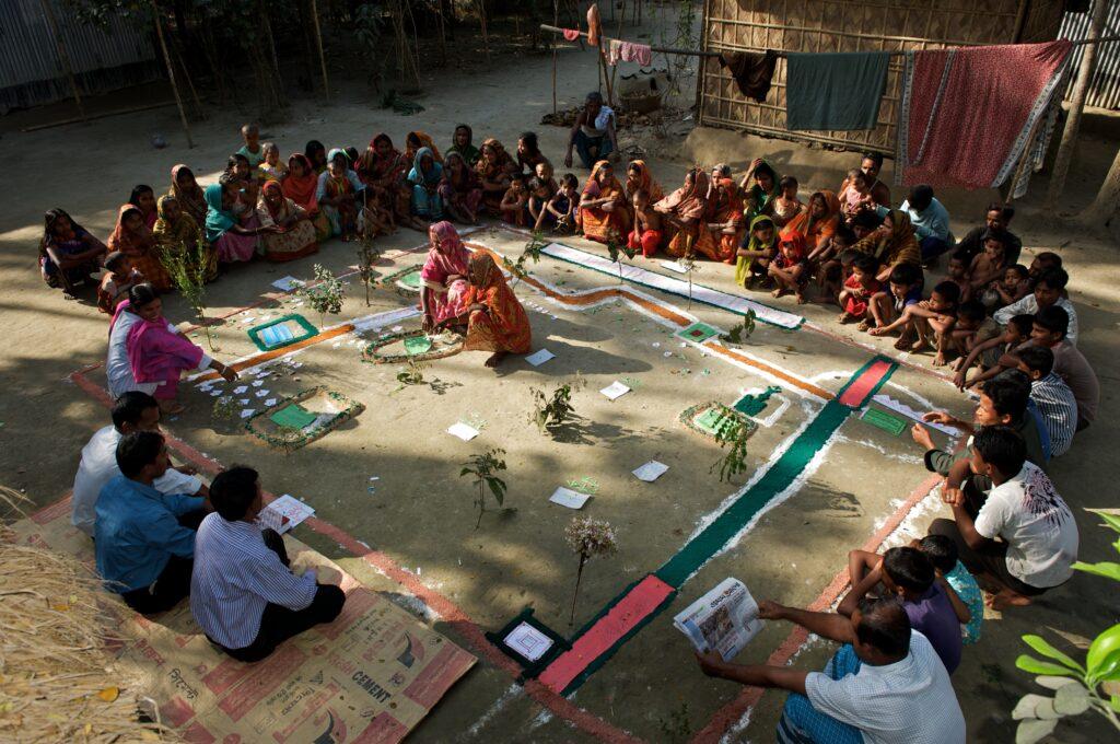 Community members in Bangladesh take part in a participatory rural appraisal.